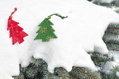 Christmas tree toy in snowfall — Stock Photo