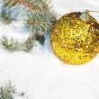 Stock Photo: Christmas ball on winter tree with snowfall