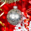 Christmas ball on fir branch — Stock Photo