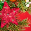 Stock Photo: Christmas background. fir branches and cones on red