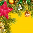Christmas background. fir branches and cones on yellow — Stock Photo