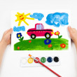 Stock Photo: Child draws the car watercolors