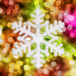 Big snowflake toy on colorful background — Stockfoto