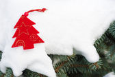 Christmas tree toy in snow — Stock Photo