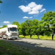 White truck on summer road — Stock Photo