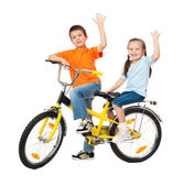 Boy and girl on bicycle isolated on white — Stock Photo