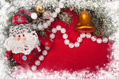 Christmas decoration on red — Stock Photo