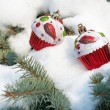 Stock Photo: Christmas toy cakes on winter tree with snow
