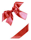 Red bow made from silk ribbon — Stock Photo