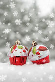 Two toy cakes on snow decoration — Stock Photo