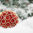Red christmas ball on fir tree with snow — Stok fotoğraf