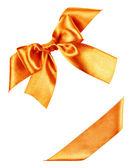 Złoty łuk z jedwabne wstążki — Zdjęcie stockowe