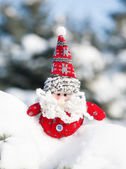 Santa toy in snowdrift with snow — Stock Photo