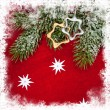 Christmas decoration and toys on red textile — Stock Photo