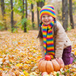 Girl in autumn park with pumpkin and apples — Stock Photo