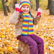 Girl in autumn park — Stock Photo #34178175