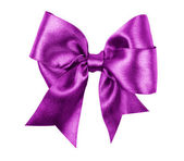 Purple bow made from silk ribbon — Stock Photo