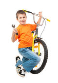 Boy repair bicycle — Stock Photo