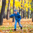 Stock Photo: Boy runs in autumn park