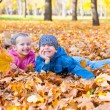 Childs in autumn park — Stock Photo #34406591