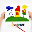 Stock Photo: Child draws the home watercolors