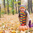 Girl in autumn park with pumpkin and apples — Foto de Stock