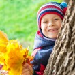 Smiling boy portrait in autumn park — Stock Photo