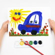 child draws the car watercolors — Stock Photo #35013603
