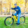 Boy rides a bicycle in park — Stock Photo #35820345