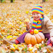 Girl in autumn park with pumpkin and apples — ストック写真