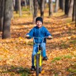 Boy rides a bicycle in park — Stock Photo #35837981