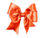 Light red bow made from silk ribbon — Stock Photo