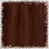 Snow frame on maroon wood background — Stock Photo