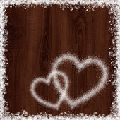 Heart shape from snow on maroon wood background — Stock Photo
