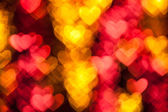 Red heart shape holiday background — Stock Photo
