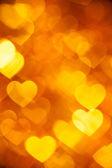 Золотое сердце формы отдыха фон — Стоковое фото