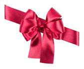 Red bow made from silk ribbon isolated — Stock Photo