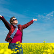 Woman in yellow field of rapeseed — Stock Photo #45066425