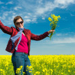 Woman in yellow field of rapeseed — Stock Photo #45066479