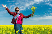 Woman in yellow field of rapeseed — Stock Photo