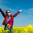 Woman in yellow field of rapeseed — Stock Photo #45295919