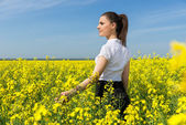 Business woman at the field — Stock Photo