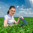Girl with notebook on green field — Stock Photo #46414695