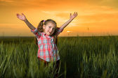 Girl open arms at sunset — Stock Photo