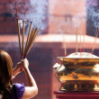 Woman holding incense sticks — Foto Stock