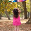 Girl with rainbow umbrella — Stock Photo