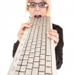 Business woman biting keyboard — Stock Photo #13371125