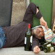 Drunk man lying — Stock Photo #13371368