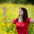 Woman in yellow flowers — Stock Photo