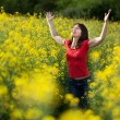 Woman in rape field — Stock Photo